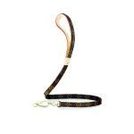 Elegantní kožené vodítko s potiskem Monogram s kovovými zlatými aplikacemi můžete mít od Louis Vuitton