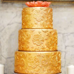 37616317 - sweet table with big golden cake for wedding party