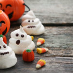86818058 - halloween meringue with candies on grey wooden table