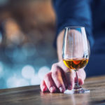 Alcoholism. Hand alcoholic or barman and drink the distillate brandy or cognac.